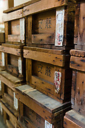 Boxes of glass to be used in the enamelling process. Ando Cloisonne, Nagoya, Aichi Prefecture, Japan, February 26, 2018. Family-owned and run Ando Cloisonne was founded in the 1880s and is the only large manufacturer of cloisonne metalware left in Japan. The cloisonne enamelling process is technologically complex and a single work may feature over 50 colours.