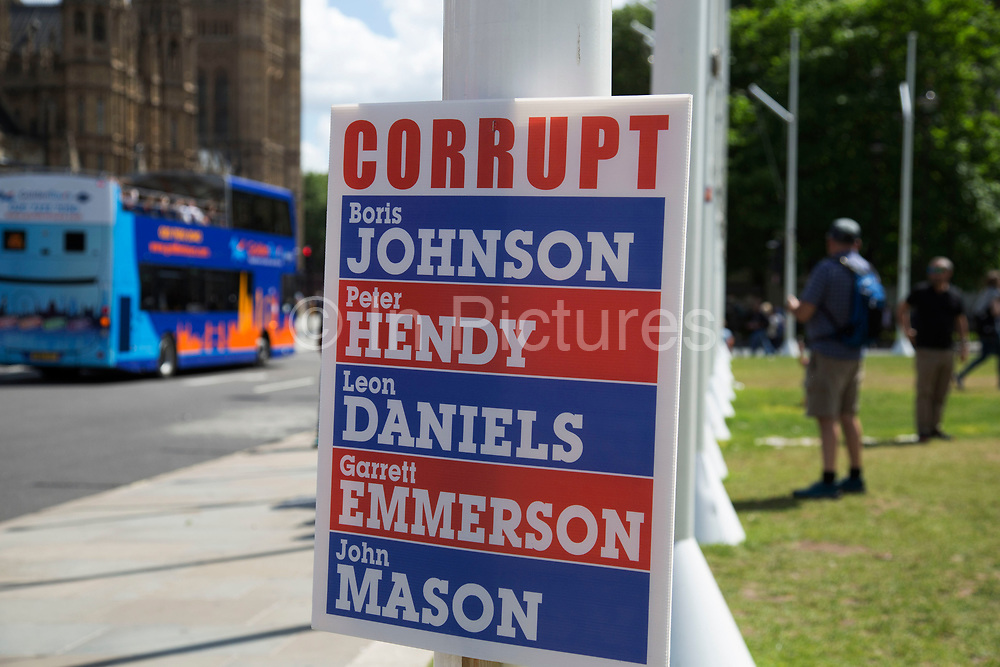 Placard listing allegedly corrupt politicians in Westminster outside the Houses of Parliamant following a Leave vote, also known as Brexit as the EU Referendum in the UK votes to leave the European Union on June 24th 2016 in London, United Kingdom. Membership of the European Union has been a topic of debate in the UK since the country joined the EEC, or Common Market in 1973. It will be the second time the British electorate has been asked to vote on the issue of Britains membership: the first referendum being held in 1975, when continued membership was approved by 67% of voters. The two sides are the  Leave Campaign, commonly referred to as a Brexit, and those of the Remain Campaign who are also known as the In Campaign.