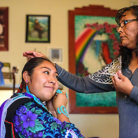 Twenty-year-old Tyra Quetawki prepares for a day as Miss Zuni with help from her mother Michele in Zuni Wednesday.