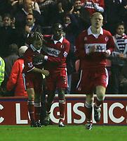 Fotball<br /> England 2004/2005<br /> Foto: SBI/Digitalsport<br /> NORWAY ONLY<br /> <br /> Middlesbrough v Fulham, Barclays Premiership, Riverside Stadium, Middlesbrough 19/04/2005.<br /> Middlesbrough's Bolo Zenden (L) is congratulated on scoring the equaliser by team-mate Ugo Ehiogu (C).