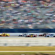 Sprint Cup Series driver Joey Logano (22) leads the pack down the backstretch during the 57th Annual NASCAR Daytona 500 race at Daytona International Speedway on Sunday, February 22, 2015 in Daytona Beach, Florida.  (AP Photo/Alex Menendez)