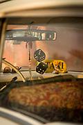 Taxi interior with dice and sunglasses, Havana, Cuba