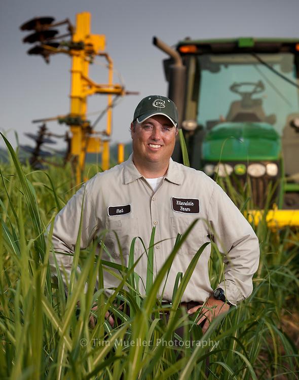 Slattery McCollam, manager of Ellendale Farms, stands in waist-high sugarcane in a field in Terrebonne Parish, Louisiana.