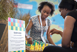 24 July 2018, Amsterdam, the Netherlands: Women play Queer Chess in the Global Village area of AIDS 2018. The Global Village is an integral part and recurring feature of the International AIDS Conference, held in 2018 in Amsterdam, the Netherlands, and offers an accessible venue intended to strengthen the connection between the international conference and the local hosting community.