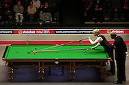 Neil Robertson (Aus) plays a shot with the rest. Ronnie O'Sullivan (Eng) v Neil Robertson (Aus), Quarter-Final match at the Dafabet Masters Snooker 2017, at Alexandra Palace in London on Thursday 19th January 2017.<br /> pic by John Patrick Fletcher, Andrew Orchard sports photography.