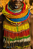 Nyangatom tribe woman wearing layers of beaded necklaces as decoration. Omo Valley, Ethiopia., Omo Valley, Ethiopia.
