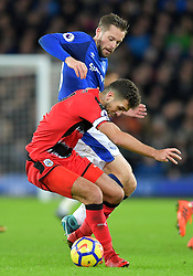 """Everton's Gylfi Sigurdsson (top) and Huddersfield Town's Tommy Smith in action during the Premier League match at Goodison Park, Liverpool. PRESS ASSOCIATION Photo Picture date: Saturday December 2, 2017. See PA story SOCCER Everton. Photo credit should read: Dave Howarth/PA Wire. RESTRICTIONS: EDITORIAL USE ONLY No use with unauthorised audio, video, data, fixture lists, club/league logos or """"live"""" services. Online in-match use limited to 75 images, no video emulation. No use in betting, games or single club/league/player publications."""