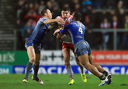 Wakefield Trinity Wildcats' Reece Lyne (right) and Sam Williams tackle St Helens' Mark Percival during the Betfred Super League match at the Totally Wicked Stadium, St Helens.