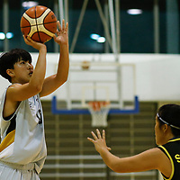 Juliana Ang (#19) of Singapore Institute of Management shoots the ball against (#9) of Singapore Polytechnic. (Photo © Lim Yong Teck/Red Sports)