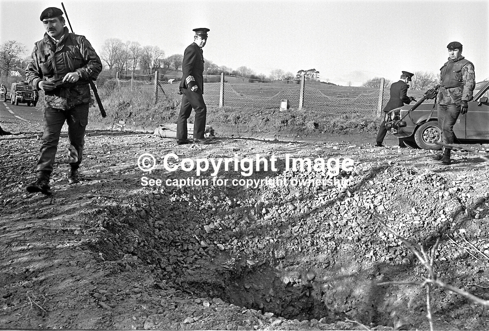 Police & army at the scene of a Provisional IRA 200lb boobytrap bomb explosion at Clare, near Cookstown, Co Tyrone, N Ireland, on 7th February 1976. Intended to lure police or army personnel to investigate what appeared to be a crashed car in a field the innocent victims were instead  a teenage brother and sister who lived nearby and as Good Samaritans had stopped to investigate. The brother and sister who died were Rachel McLernon, 21 years, and Robert McLernon, 16 years. 197602080084b.<br /> <br /> Copyright Image from Victor Patterson, Belfast, UK<br /> <br /> t: +44 28 9066 1296 (from Rep of Ireland 048 9066 1296)<br /> m: +44 7802 353836<br /> e: victorpattersonbelfast@gmail.com<br /> <br /> www.images4media.com<br /> <br /> Please see my full Terms and Conditions of Use at https://www.images4media.com/p/terms-conditions - it is IMPORTANT that you familiarise yourself with them.<br /> <br /> Images used online incur an additional cost. This cost should be agreed in writing in advance. Online images must be visibly watermarked i.e. © Victor Patterson or that of the named photographer within the body of the image. The original metadata must not be deleted from images used online.<br /> <br /> This image is only available for the use of the download recipient i.e. television station, newspaper, magazine, book publisher, etc, and must not be passed on to a third party. It is also downloaded on condition that each and every usage is notified within 7 days to victorpattersonbelfast@gmail.com.<br /> <br /> The right of Victor Patterson (or the named photographer) to be identified as the author is asserted in accordance with The Copyright Designs And Patents Act (1988). All moral rights are asserted.