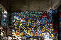 Graffiti at Manazuru Abandoned Barbeque - Block Art House is a popular place for hip hop artists and graffiti artists to show their stuff, in fact the entire abandoned building is covered in the stuff.  Though it is officially off-limits, people still seem to find their way in to explore, photograph the place or paint the walls. The place itself was once an old barbecue restaurant that went bust, constructed on a cliff.  This place is now only used by street artists and covered with interesting graffiti.