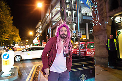 "© Licensed to London News Pictures . 28/10/2018. Manchester, UK. A man wearing a pink wig and unicorn horn , outside a club in Manchester's "" Gay Village "" . Revellers on a night out , many in fancy dress , on the weekend before Halloween . Photo credit: Joel Goodman/LNP"