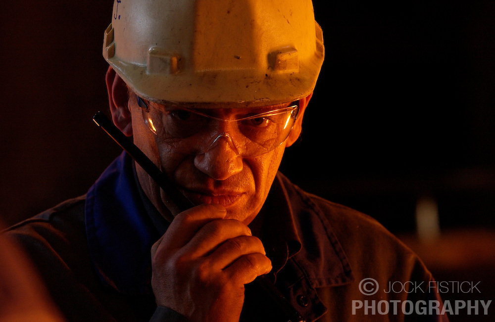 An Arcelor employee works in a blast furnace at the Seraing facility near Liege, Belgium. (Photo © Jock Fistick)