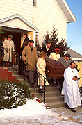 Grandchildren pallbearers carrying Grandmother to grave.  Garden City Iowa USA