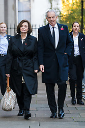 © Licensed to London News Pictures. 10/11/2019. London, UK. Former Prime Minister, Tony Blair and his wife, Cherie walks through Downing Street to attend the Remembrance Sunday Ceremony at the Cenotaph in Whitehall. Remembrance Sunday events are held across the country today as the UK remembers and honours those who have sacrificed themselves in two world wars and other conflicts. Photo credit: Vickie Flores/LNP