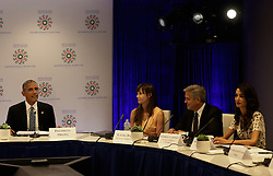 September 20, 2016 - New York, New York, United States of America - United States President Barack Obama (L) with US actor George Clooney (2ndR) and wife Amal Clooney (L) attend a Private Sector CEO Roundtable Summit for Refugees during the United Nations 71st session of the General Debate at the United Nations General Assembly at United Nations headquarters in New York, New York, USA, 20 September 2016..Credit: Peter Foley / Pool via CNP (Credit Image: © Peter Foley/CNP via ZUMA Wire)