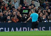 Football - 2018 / 2019 UEFA Champions League - Quarter Final , First Leg: Tottenham Hotspur vs. Manchester City<br /> <br /> Referee Björn Kuipers (NED) checks the VAR before awarding a penalty to Manchester City at White Hart Lane Stadium.<br /> <br /> COLORSPORT/DANIEL BEARHAM