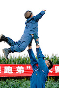 GU\'AN, CHINA - AUGUST 31: (CHINA OUT) <br /> <br /> 5-year-old Boy Flies In Beijing<br /> <br /> 5-year-old Duo Duo prepares to fly over the Beijing Wildlife Park on August 31, 2013 in Gu'an, Hebei Province of China. Duo Duo, accompanied by his coach, piloted a light aircraft by himself over the Beijing Wildlife Park on Saturday afternoon. At around 6:08 p.m., Duo Duo took off from an airfield in Gu\'an county of Hebei province, and flew to the Beijing Wildlife Park, which is 15 kilometers away in Daxing district of Beijing, and returned. The whole flight took just 35 minutes, according to Duo Duo\'s father, He Liesheng. He Liesheng said that he wants his son to become braver by flying a plane and develop his curiosity and desire to explore. Duo Duo started his flight training at the beginning of August this year, with the cost of more than 30,000 yuan (4,900 USD).<br /> ©Exclusivepix