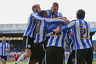 Sheffield Wednesday striker Gary Hooper (14) is mobbed by his players after his goal 1-0 during the Sky Bet Championship match between Sheffield Wednesday and Cardiff City at Hillsborough, Sheffield, England on 30 April 2016. Photo by Phil Duncan.