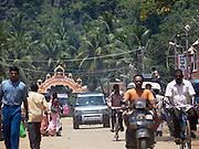 A 4x4 vehicle travels along a busy street, Cochin, Kerala, India