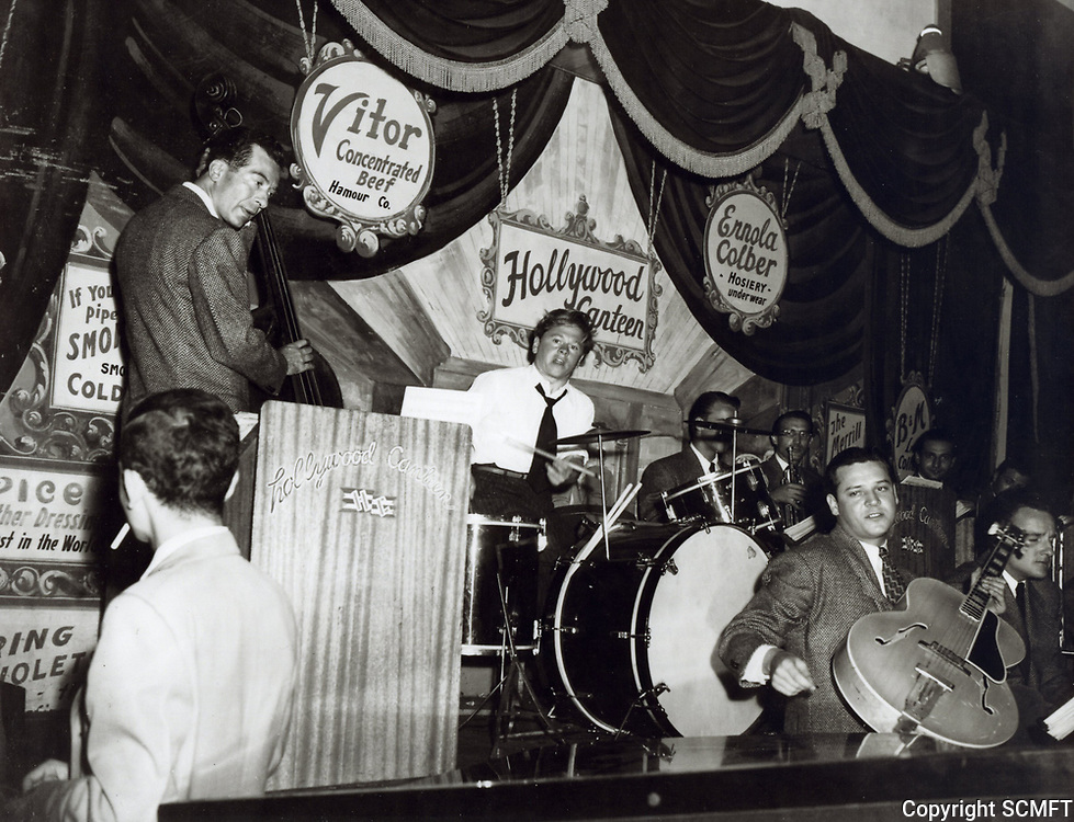 1943 Mickey Rooney playing the drums at the Hollywood Canteen