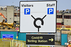 © Licensed to London News Pictures. 16/09/2020. WATFORD, UK.  A sign directing drivers to the Covid-19 testing centre outside Watford General Hospital in Hertfordshire.  Following the UK government's Operation Moonshot announcement committing to 10 million tests per day, it is reported that the increased demand for Covid-19 tests has led to local shortages of testing slots.  Photo credit: Stephen Chung/LNP