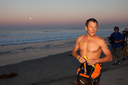 Sept. 30, 2012 - Corondo, California, U.S. - Lance Armstrong, whom the U.S. Anti-Doping Agency handed a lifetime ban to in August, took part in the Superfrog Triathlon in Coronado on Sunday. While banned from sanctioned events falling under the umbrella of the World Anti-Doping Agency's jurisdiction, Armstrong is free to compete in events like Superfrog. (Credit Image: © Daren Fentiman/ZUMAPRESS.com)