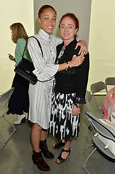 Left to right, ADWOA ABOAH and CAMILLA LOWTHER at a lunch in aid of the charity African Solutions to African Problems (ASAP) held at the Louise T Blouin Foundation, 3 Olaf Street, London W11 on 21st May 2014.