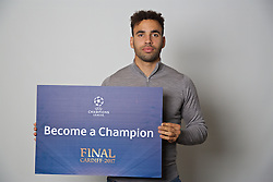 "CARDIFF, WALES - Monday, November 7, 2016: Wales' Hal Robson-Kanu holds up a board ""Become a Champion"" to encourage people to become volunteers for the 2017 UEFA Champions League Final in Cardiff. (Pic by David Rawcliffe/Propaganda)"