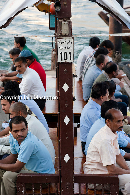 View of Abra water taxi passengers on Creek in Old Dubai in United Arab Emirates UAE