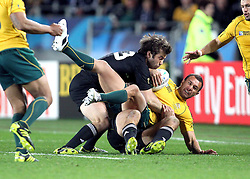 © Andrew Fosker / Seconds Left Images 2011 - Australia's Quade Cooper is dumped by New Zealand's Conrad Smith -  Australia v New Zealand - Rugby World Cup 2011 - Semi Final - Eden Park - Auckland - New Zealand - 16/10/2011 -  All rights reserved..