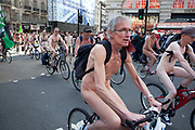 Naked people cycling around Piccadilly in London, England, UK. Cyclists in cities around the world took part in the World Naked Bike Ride. Started in 2004, the clothing-optional protest aims to promote cycling as a greener mode of transportation, and encourage a body-positive culture.