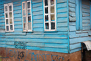 Elegant Queens, graffiti, on an old wooden house in downtown Freetown, Sierra Leone