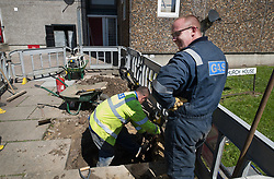 © Licensed to London News Pictures. 11/08/2017. London, UK. Gas company employees work on the Ledbury Estate as the gas supply is switched off. Residents on the Ledbury Estate in south London have been told they will have to leave their properties over the next few weeks. A structural survey carried out after the Grenfell fire found cracks that could lead to a collapse if a gas explosion occured in one of the flats. Photo credit: Peter Macdiarmid/LNP