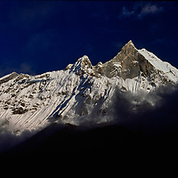 Machhapuchare Peak towers over the Annapurna Sanctuary of the Nepal Himalaya.