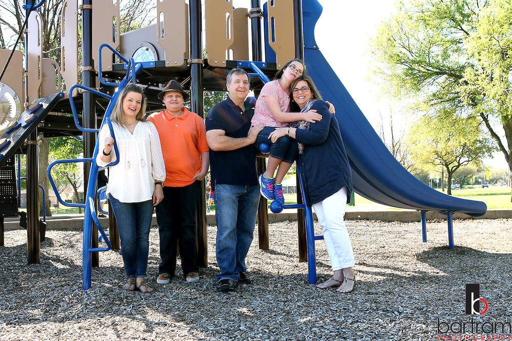 Jennifer Andrick, right, with her husband Tom Andrick  and her children Jessica Walker, Trevor Andrick and Allie Andrick on  Saturday, April 2, 2016 in Plano, Texas. (Photo by Kevin Bartram)