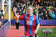 Comedian Eddie Izzard who completed 27 marathons in 27 days across South Africa, all to raise money for Sport Relief runs in a Crystal Palace home shirt to high five the fans during half time break. Barclays Premier League match, Crystal Palace v Norwich city at Selhurst Park in London on Saturday 9th April 2016. pic by John Patrick Fletcher, Andrew Orchard sports photography.