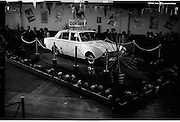 """Launch Of New Ford Corsair..1963..01.10.1963..10.01.1963..1st October 1963..Today saw the launch of a new car to the market. At the Smithfield Motor Company in Drumcondra, Ford launched """"The Corsair"""".,The Corsair was one of the four model Consul range, and shared many of its mechanical components with the Cortina, Classic and Capri. The Corsair had unusual and quite bold styling for its day, with a sharp horizontal V-shaped crease at the very front of the car into which round headlights were inset...Image shows the New Ford Corsair on the display stand at the Smithfield Motor Company in Drumcondra."""