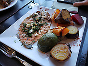 Delicious trout and barbequed vegetables on a square plate. El Muro Restaurant is highly recommended, in El Chalten resort, Argentina, Patagonia, South America.