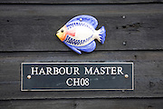 Ceramic fish on harbour master shed close up, Felixstowe Ferry, Suffolk