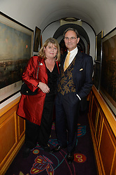 COLIN & LINDY WOODHEAD at a 1970's themed party as part of Annabel's 50th anniversary celebrations, held at Annabel's, Berkeley Square, London on 24th September 2013.