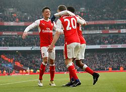 22 January 2017 London : Premier League Football : Arsenal v Burnley :<br /> Mesut Ozil (left) celebrates with Arsenal goal scorer Shkodran Mustafi.<br /> Photo: Mark Leech