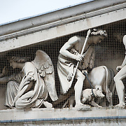 Sculptures above the main entrance to the British Museum. The British Museum in downtown London us dedicated to human history and culture and has about 8 million works in its permanent collection.