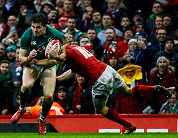 Jacob Stockdale of Ireland under pressure from Gareth Anscombe<br /> <br /> Photographer Simon King/Replay Images<br /> <br /> Six Nations Round 5 - Wales v Ireland - Saturday 16th March 2019 - Principality Stadium - Cardiff<br /> <br /> World Copyright © Replay Images . All rights reserved. info@replayimages.co.uk - http://replayimages.co.uk