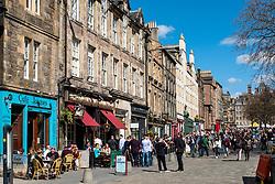 View of outdoor bars at Grassmarket in Edinburgh Old Town on sunny afternoon, Edinburgh, Scotland, UK