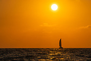 Mediterranean Sun Set, A sail boat crossing the sun at sunset