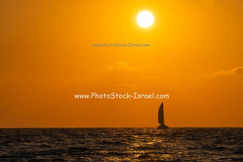 Mediterranean Sun Set, A sail boat crossing the sun at sunset