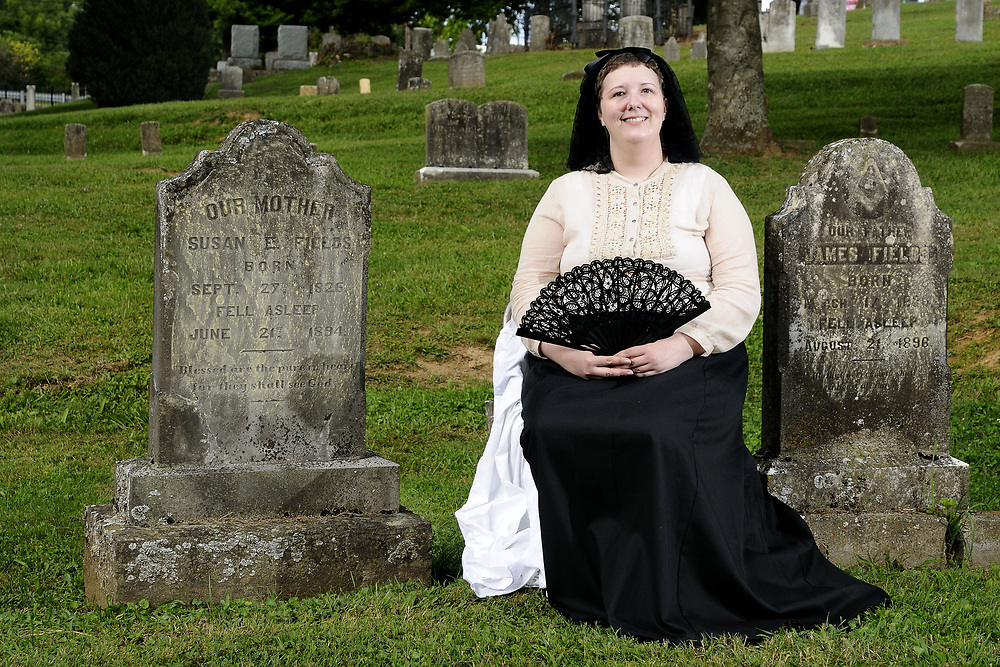 Amy Looney portrays Susan Fields at her grave site during the Living History Tour of the Sinking Spring Cemetery, presented by the Historical Society of Washington County, as part of the Virginia Highlands Festival in Abingdon, VA on Saturday, August 2, 2014. Copyright 2014 Jason Barnette