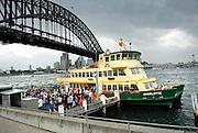 Sydney Harbour Ferry at Milsons Point wharf (Luna Park), with Sydney Harbour Bridge in background. Sydney, Australia