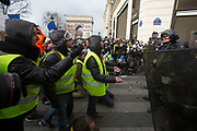 December, 8th, 2018 - Paris, Ile-de-France, France: Demonstrators arguing with riot police on Champs Elysees. The French 'Gilets Jaunes' demonstrate a fourth day. Their movement was born against French President Macron's high fuel increases. They have been joined en mass by students and trade unionists unhappy with Macron's policies. Nigel Dickinson